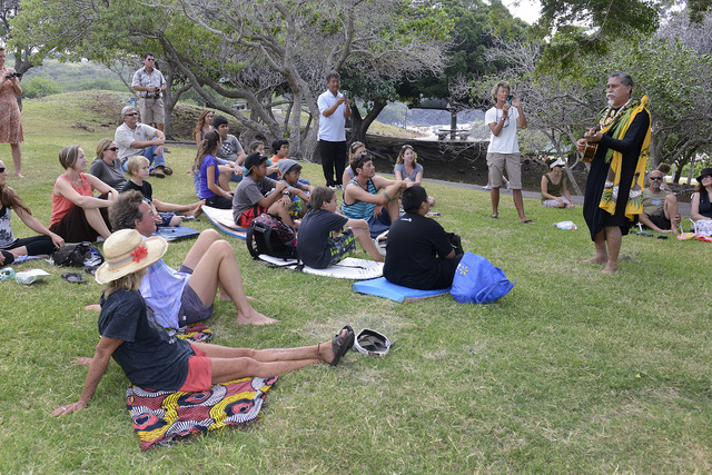"Above: ""Kahu L. Kalani Souza does some mele (music) while conducting the blessing ceremony for the pilot Hawaiian Islands Beach Clean Up Stations at Hapuna Beach State Park Friday afternoon."" Credit - West Hawaii Today"