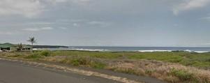 "Above: ""The coast south of Punaluu Beach, with Punaluu Beach Park at the far left."""