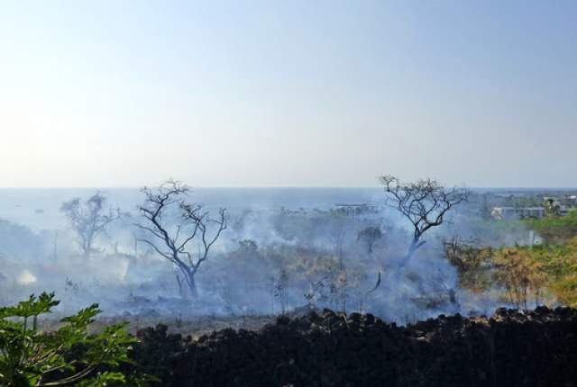 """Above:""""A brush fire consumed about 20 acres Monday afternoon in Kailua-Kona before firefighters managed to get the blaze under control."""" Credit: Chelsea Jensen/West Hawaii Today"""