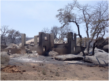 """Above: """"The wildfire in Yarnell, Ariz., last June destroyed homes and killed 19 firefighters. Experts say expansion into wildfire-prone areas has created new challenges for firefighters."""" Courtesy of NPR."""
