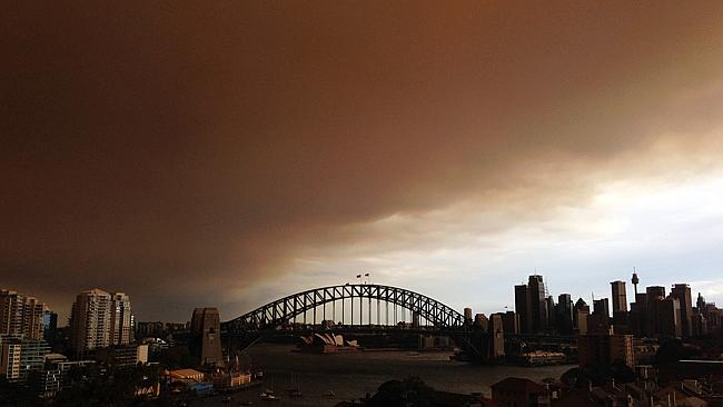 "Above: ""Harmful effect ... Sydney's CBD is shrouded in a haze of smoke from bushfires in Springwood, Winmalee and Lithgow in the Blue Mountains last October. Picture: Getty Source: Getty Images"""