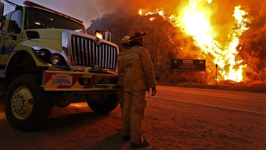 "Above: ""Firefighters monitor the Colby Fire on Highway 39, January 17, 2014, in Azusa, California."" Courtesy of CNBC."