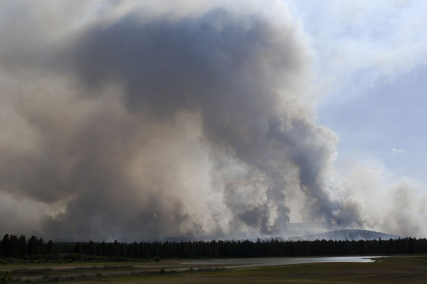 """Above: """"The Two Bulls Fire grew to 6,200 acres Sunday. Two helicopters were ferrying water from near Tumalo Reservoir to the fire about 1.5 miles away. Tankers flew over carrying retardant."""" Credit: Stephanie Yao Long/The Oregonian"""