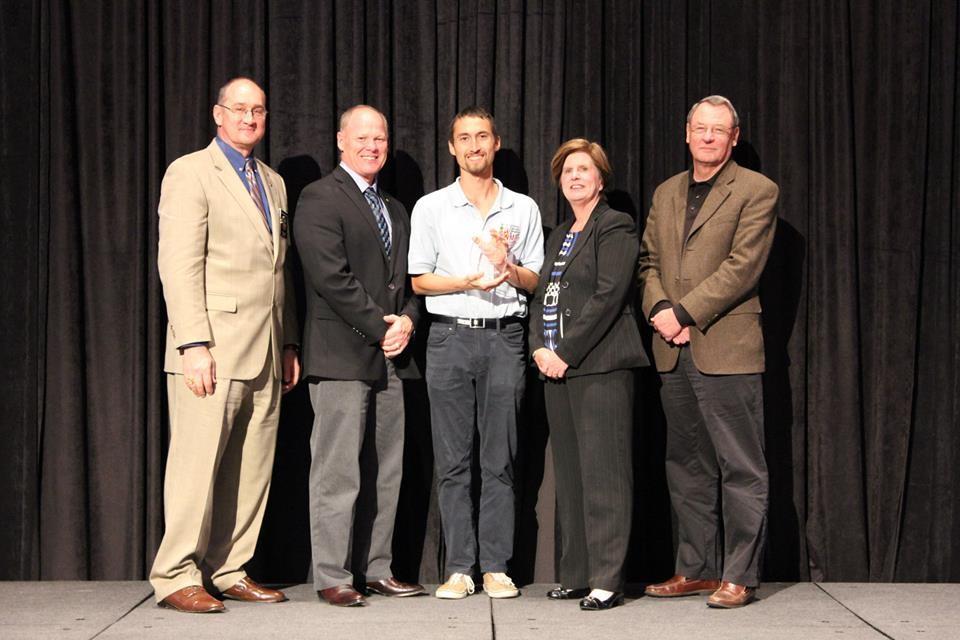 Above: Pablo Beimler accepts the Wildfire Mitigation Innovation Award on behalf of Hawaii Wildfire Management Organization.