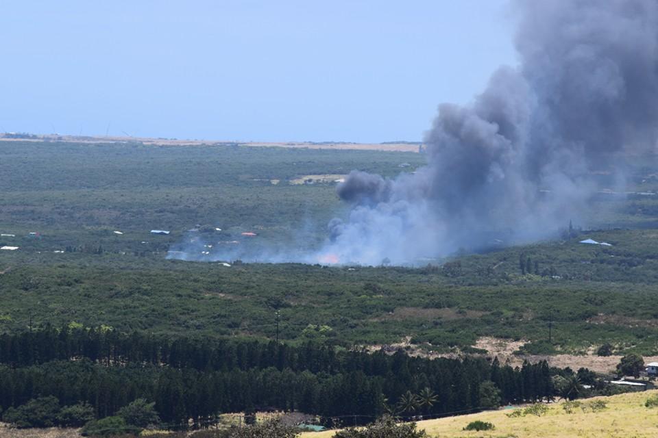 """Naalehu brush fire. Photo credit: Eric Fandrick."""