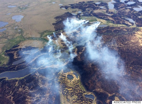 """ Smoke rises from the Bogus Creek Fire, one of two fires burning in the Yukon Delta National Wildlife Refuge in southwest Alaska. Fire managers said Monday that weekend rain helped tamp down the fires which, together, total about 63 square miles. (Matt Snyder/Alaska Division of Forestry via AP)"""