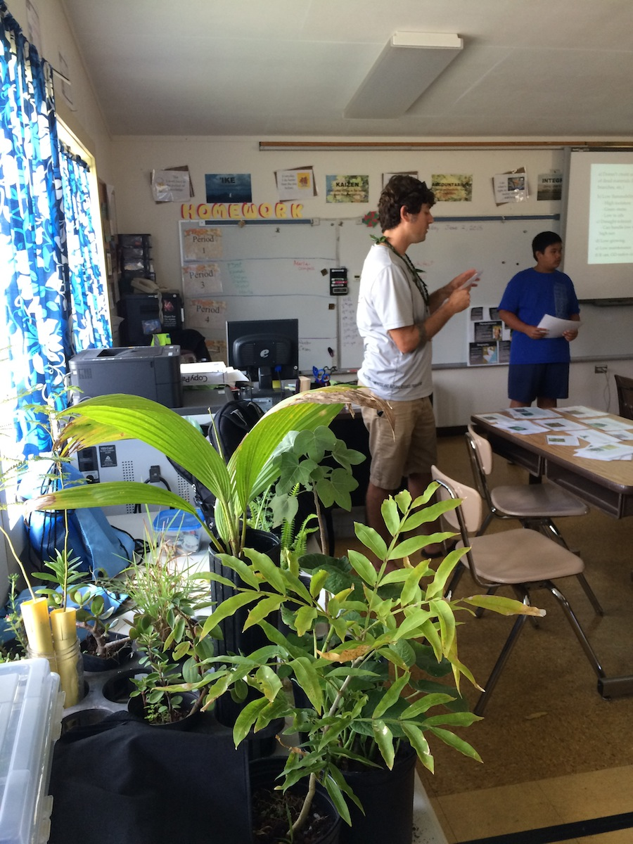 """Tom Loomis reads off a plant card for the student judges - in the front of the picture are the plants we asked them to categorize as """"good"""", """"so-so"""", or """"bad"""" Firewise plants."""