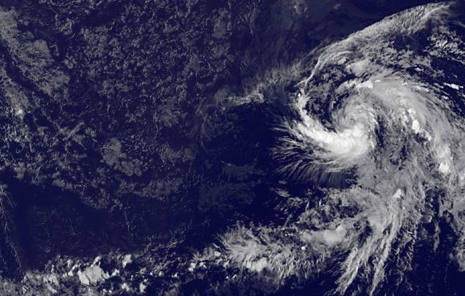 """""""Tropical Depression 6E, which formed in the Eastern Pacific over the weekend, was captured in an image at 7 p.m. Sunday by the GOES-15 geostationary satellite. Hawaii is in the upper left corner of the image. Tropical cyclone activity usually increases in El Nino years such as 2015."""" Credit - Honolulu Star-Advertiser"""