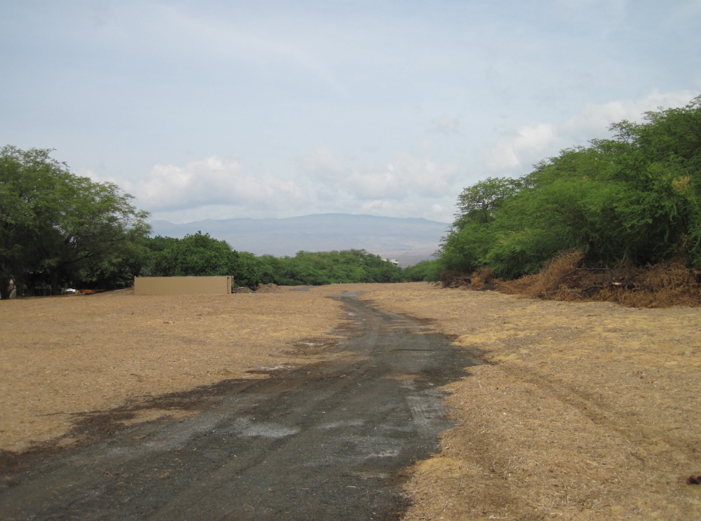 The fuelbreak protects homes from a thick  kiawe  forest that has posed a wildfire hazard for years with multiple-close calls for the village.