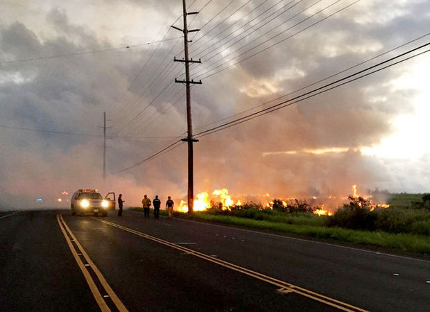 """""""Flames from a brush fire that broke out at around 4:20 a.m. near Aloha Beach Resort in Wailua came dangerously close to Kuhio Highway, causing officials to shut down the highway in both directions for over an hour."""" Credit - Kauai County"""