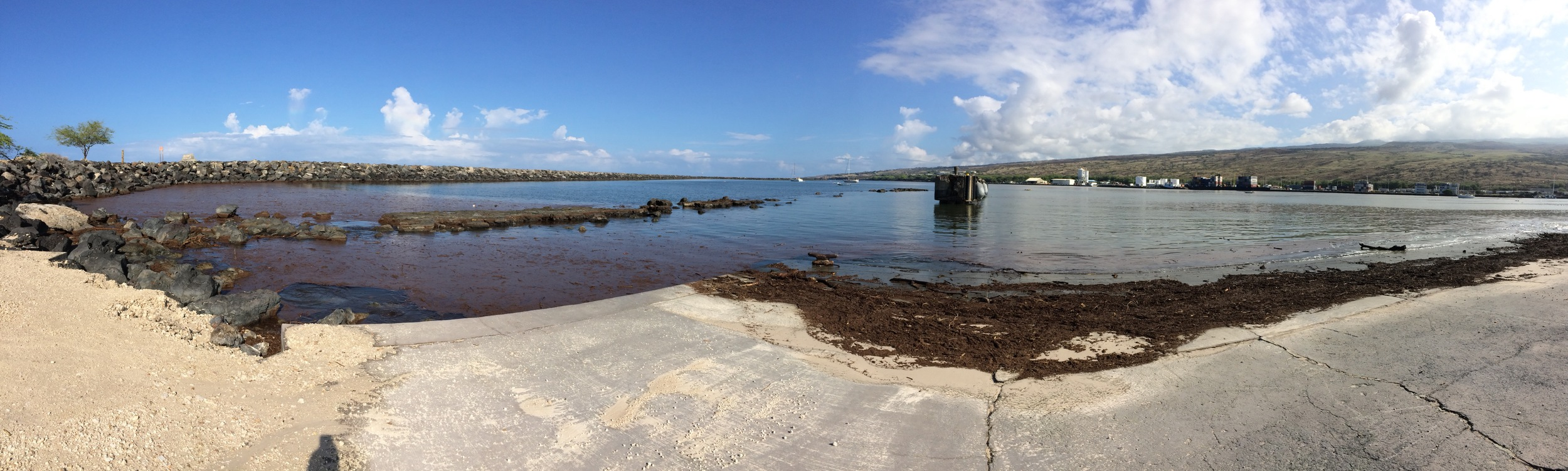 Panorama of post-fire debris covering Kawaihae Harbor.