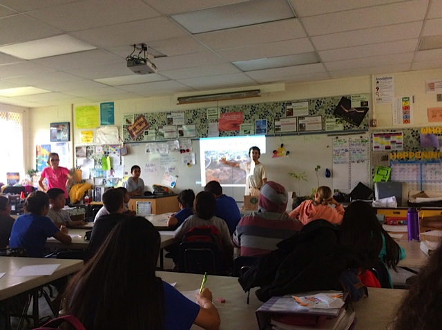 Ms. Bowman's 7th grade science class watches in awe the story of the Waikoloa fire in 2005.
