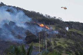 """Firefighters battled a brush fire in upper Makakilo in August 2014. Authorities later determined that the fire was started by two boys playing with a lighter."" (Krystle Marcellus/Honolulu Star Advertiser)"