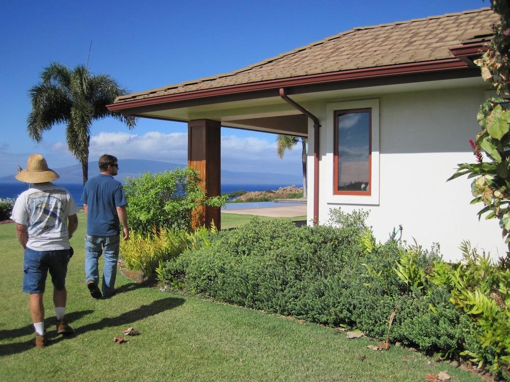 Chris Brosius (right) examines native landscaping around home.