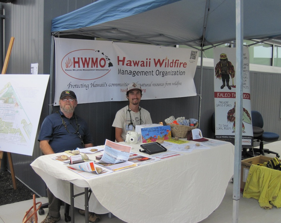 HWMO's Sam Patten (left) and Pablo Beimler (right) hold down the booth for the day.
