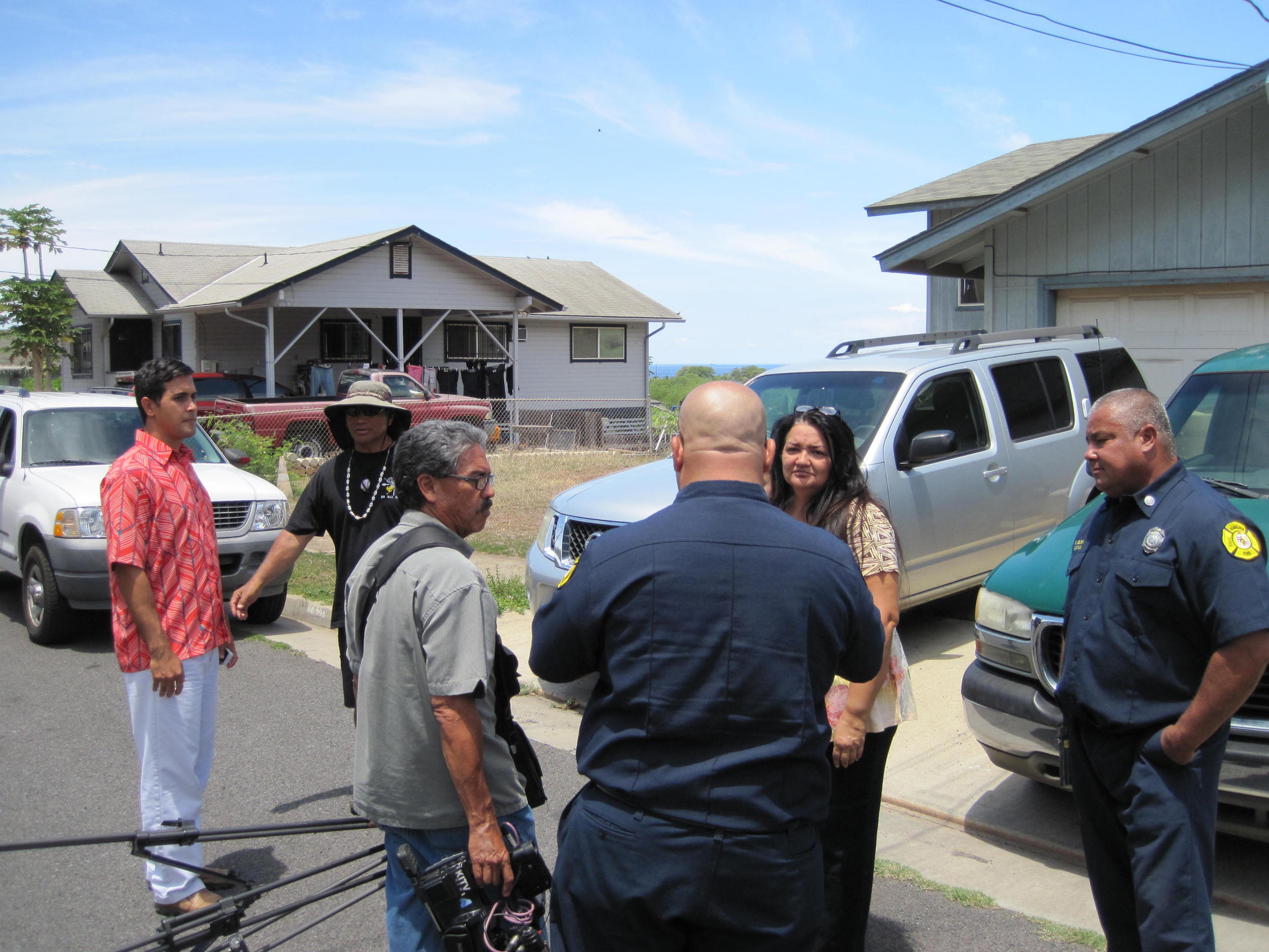 News reporters and Honolulu Fire Department talk with residents who experienced the fire first-hand and created defensible space far in advance of the fire.