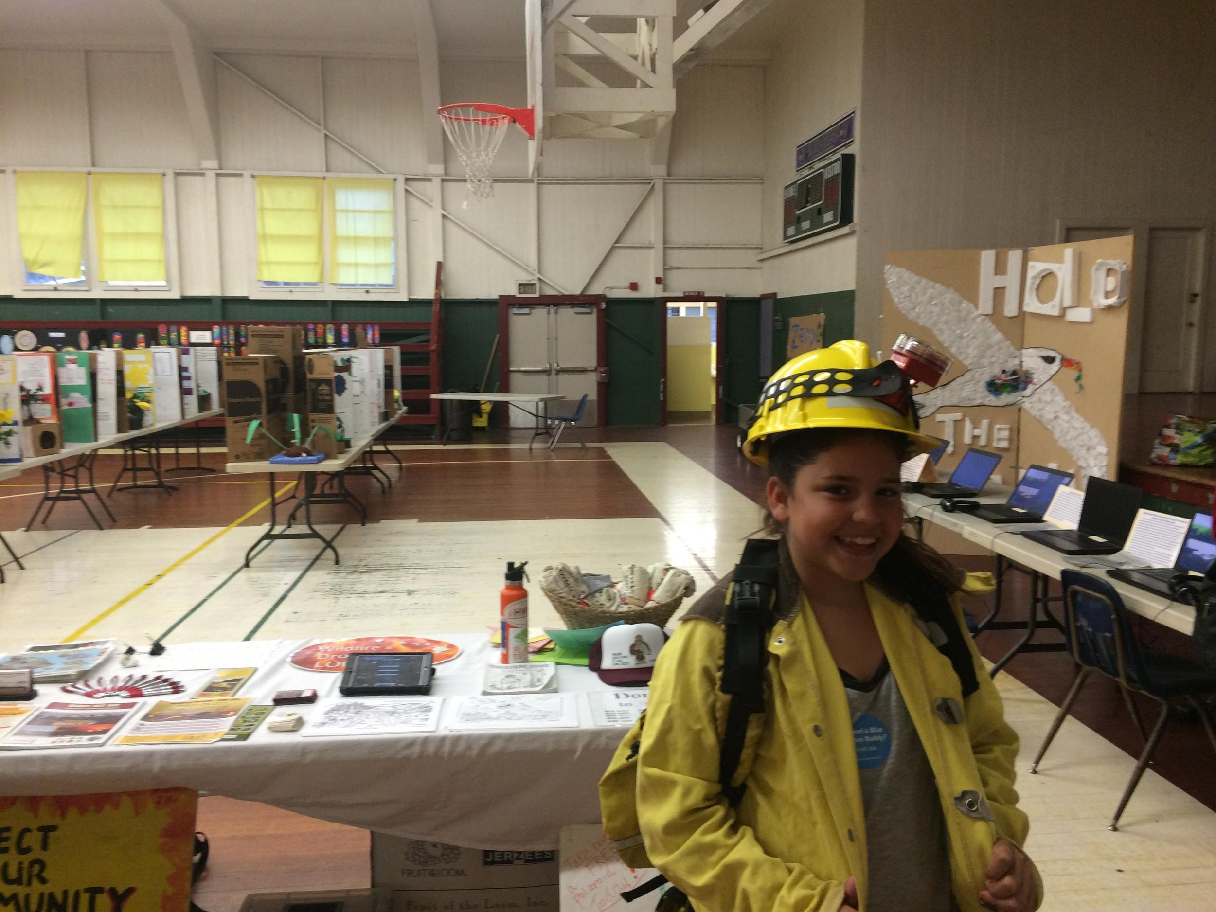 Waimea Middle School student gets dressed in wildland fire gear.
