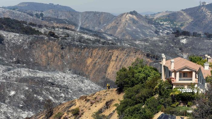 """Burned hillsides surround a home in Calabasas."" (Michael Owen Baker/AFP/Getty Images)"