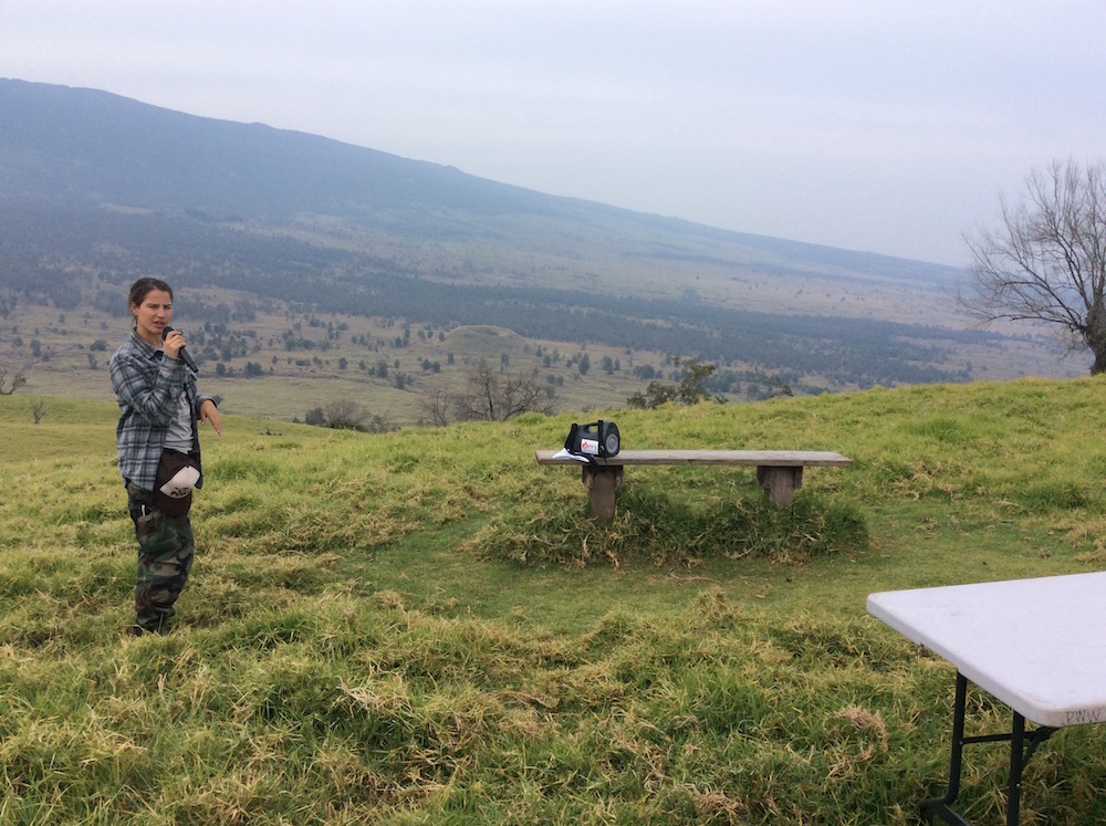 Leila Dudley, DOFAW, with Hualalai in the background, shares moʻolelo about Puʻu Waʻawaʻa and its surrounding areas.