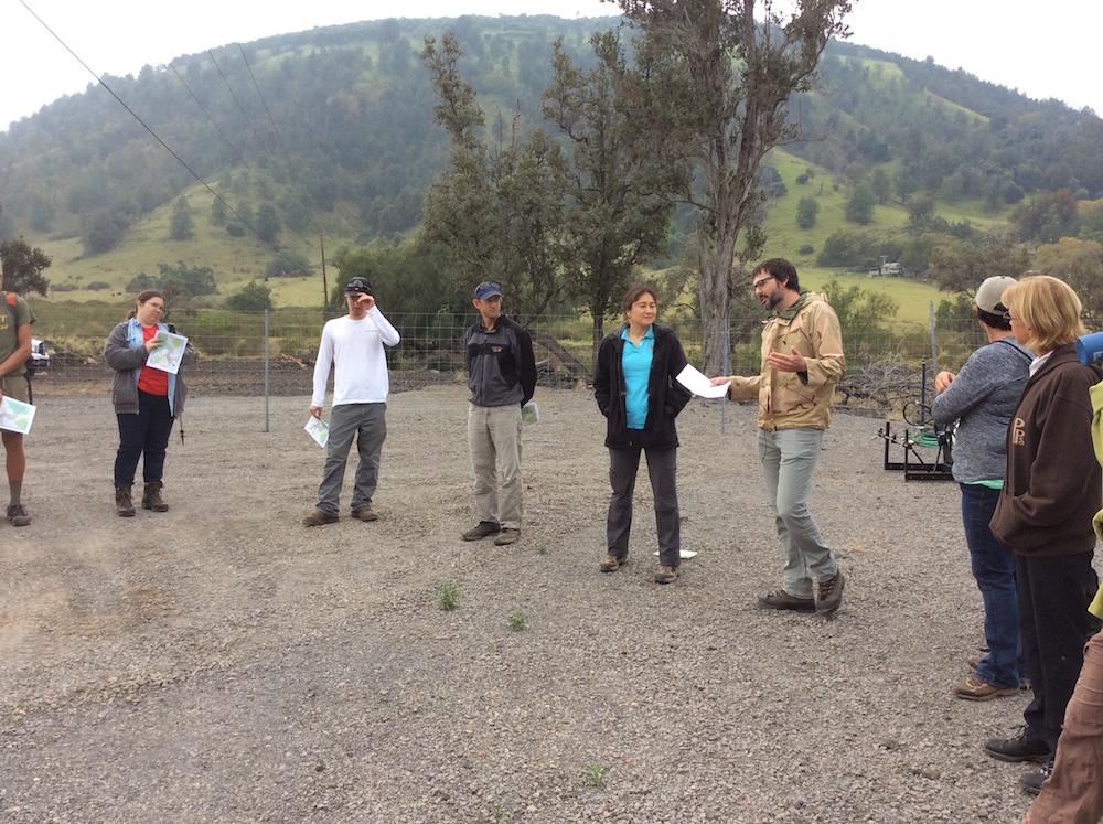 Starting the field tour in a circle at the baseyard at the foot of Puʻu Waʻawaʻa