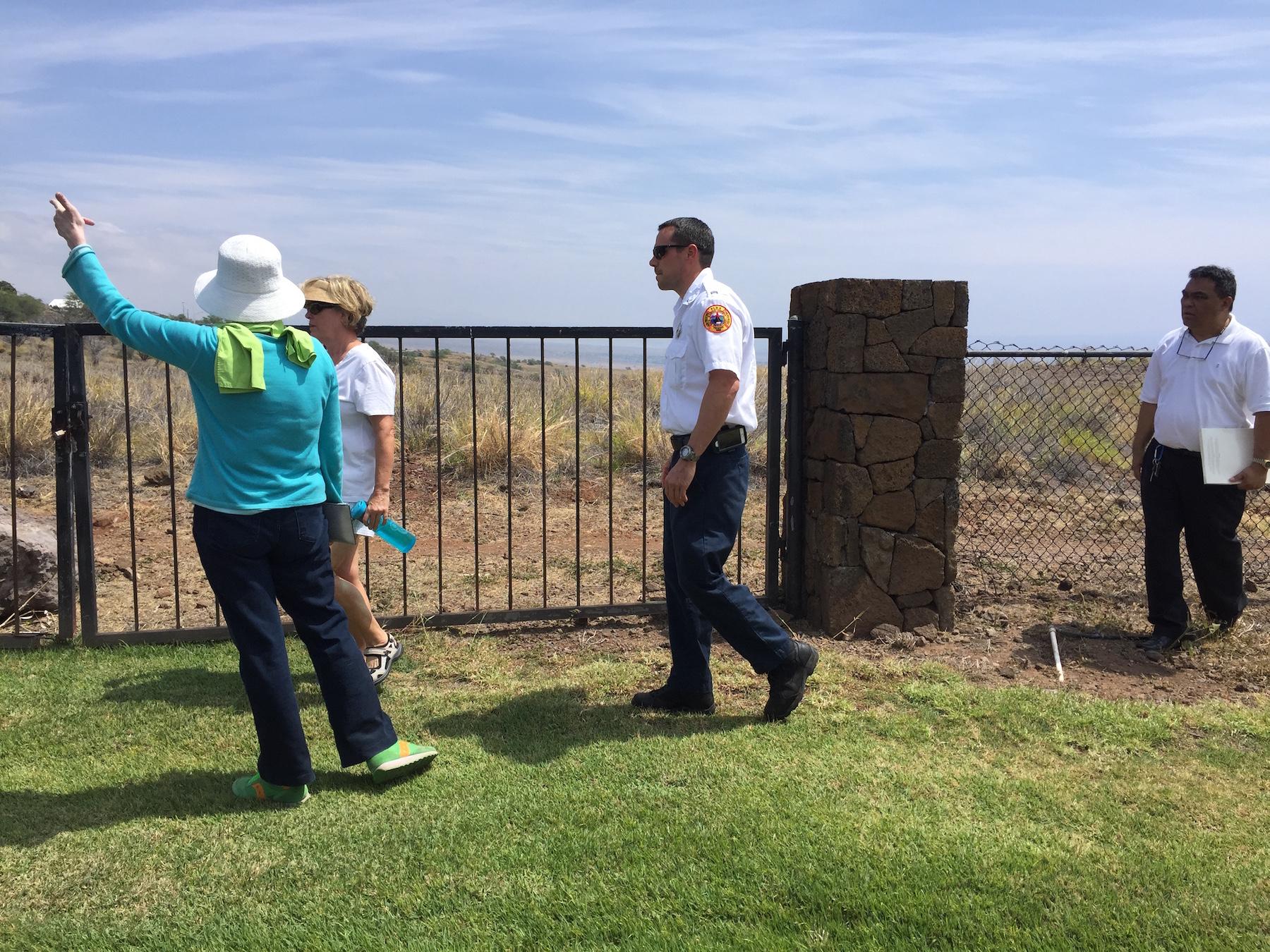 Walking the Kohala Waterfront perimeter to examine wildfire hazards.