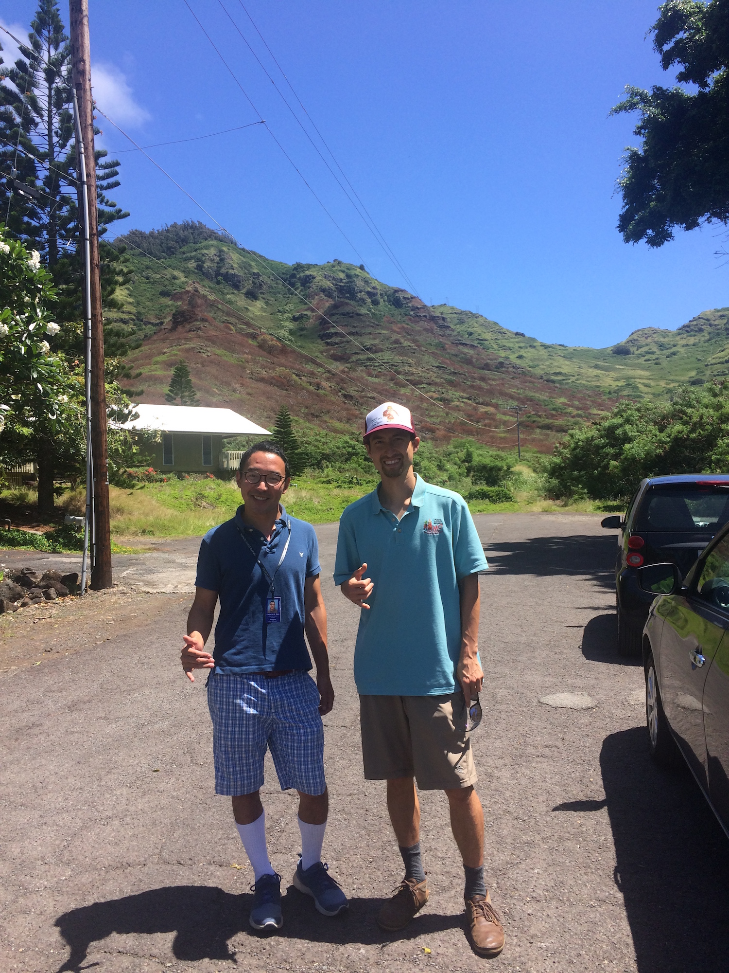 Cameron Sato (left), Office of Senator Stanley Chang, and Pablo Beimler (right), HWMO in front of Kamilonui Valley burn scar.