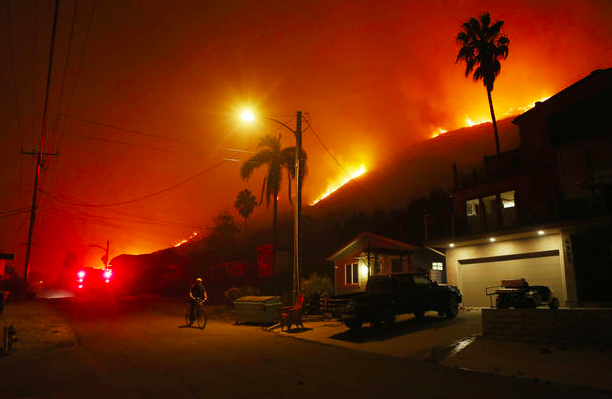 """The Thomas Fire burns on a bluff in La Conchita, California, on Dec. 7, 2017. Many evacuation holdouts were forced to flee the small seaside town as the flames approached.   Strong Santa Ana winds rapidly spread  multiple wildfires  across tens of thousands of acres, destroying hundreds of homes and other buildings.  CREDIT: Mario Tama / Getty Images"