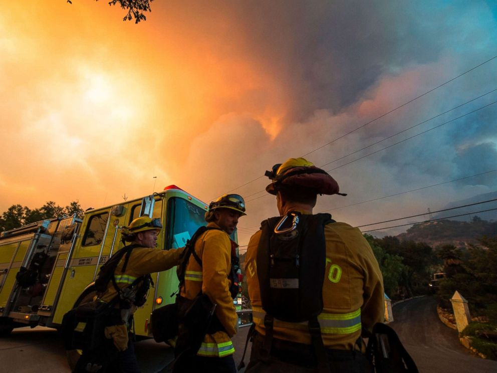 """Firefighters from the Governors Office of Emergency Services monitor the advance of smoke and flames from the Thomas Fire, Dec. 16, 2017 in Montecito, Calif."" Credit: Robyn Beck/AFP/Getty Images"