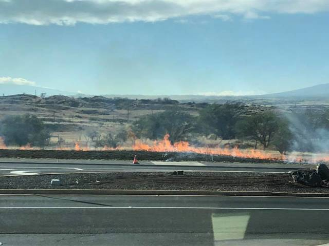 """Hawaii Fire Department quickly extinguished three brush fires along Waikoloa Road and Route 190 Monday morning. Police believe the fires to be suspicious."" Credit: Judy Wilder / West Hawaii Today"