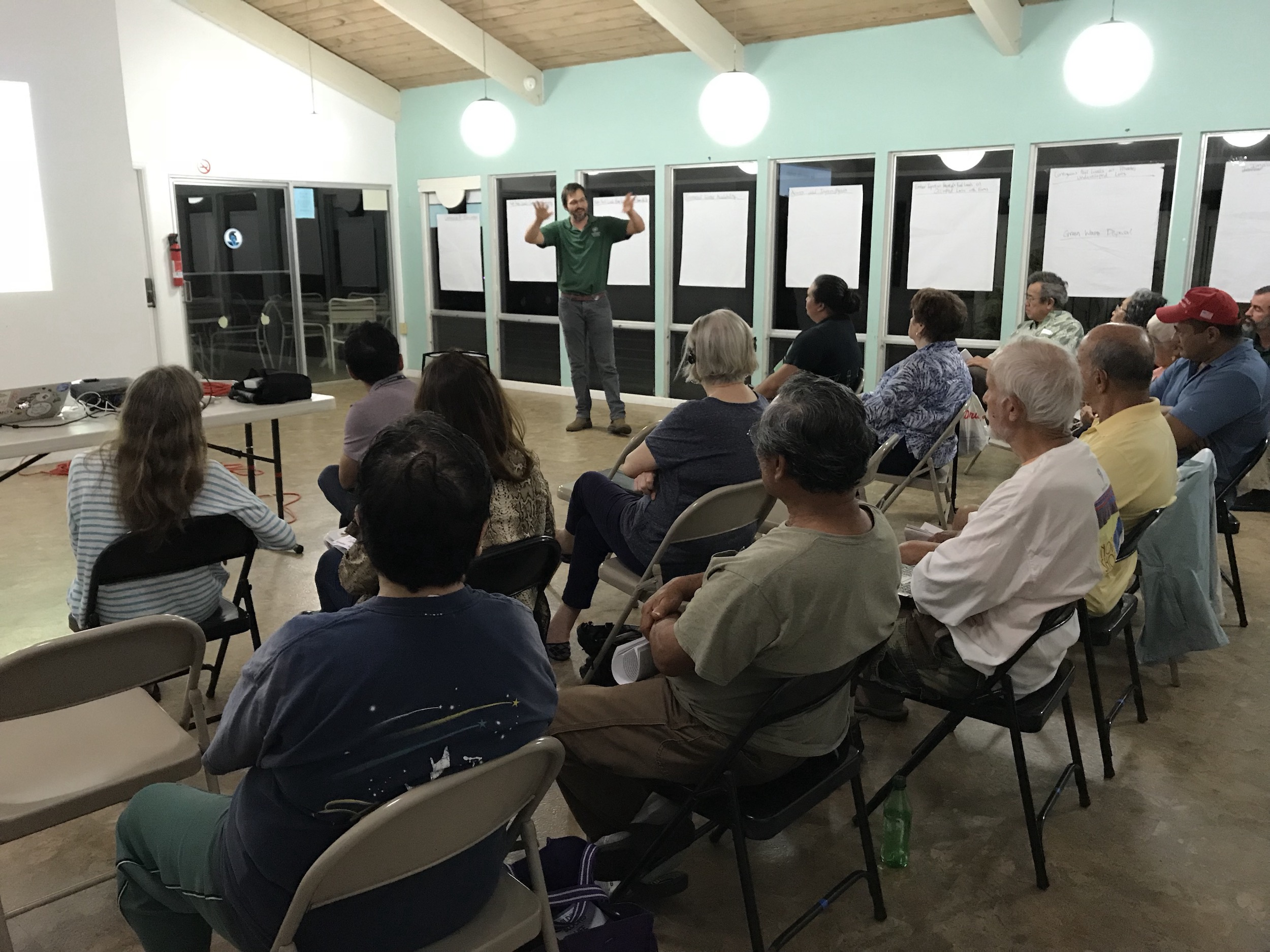 Dr. Clay Trauernicht of UH CTAHR Cooperative Extension and Pacific Fire Exchange encourages the community members in the room to continue to take proactive action in the neighborhood to prevent wildfire loss.