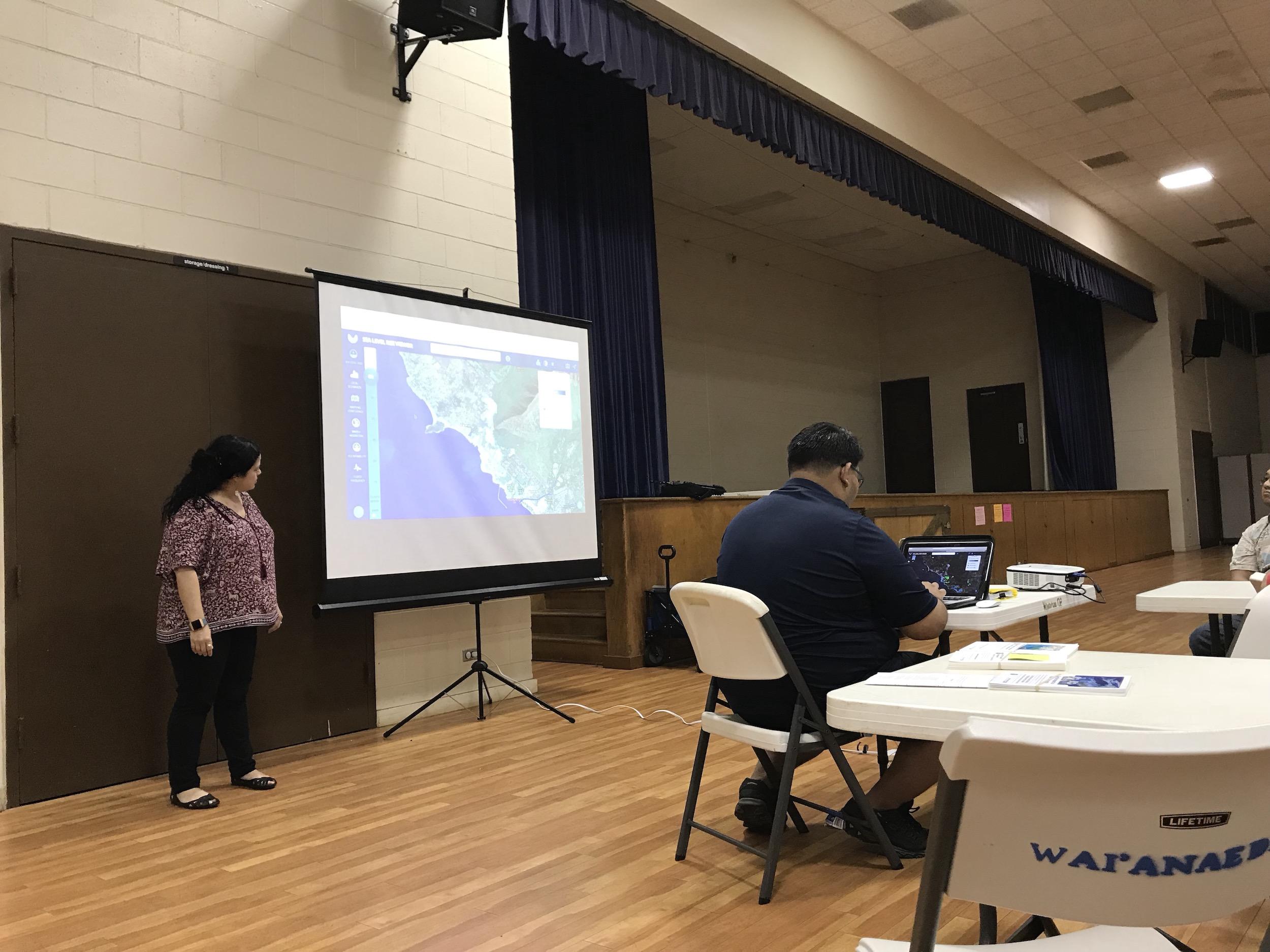Sea level rise app demo from a speaker representing NOAA.