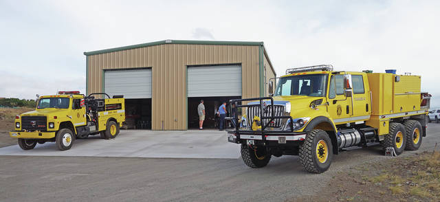 """""""9 Bravo's two fire trucks are displayed outside the new building July 20 for the open house event. The facility is located between Mauna Lani and downtown Waimea. (LANDRY FULLER/SPECIAL TO WEST HAWAII TODAY)"""""""
