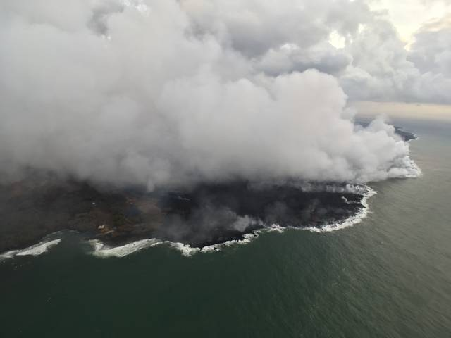 """This photo of the western margin of the lava flow at the oceanfront was taken Sunday. The western flow margin did not advance overnight, and remained approximately 0.1 mile from the Pohoiki Boat Ramp at Isaac Hale Beach Park this morning."" Credit: USGS"
