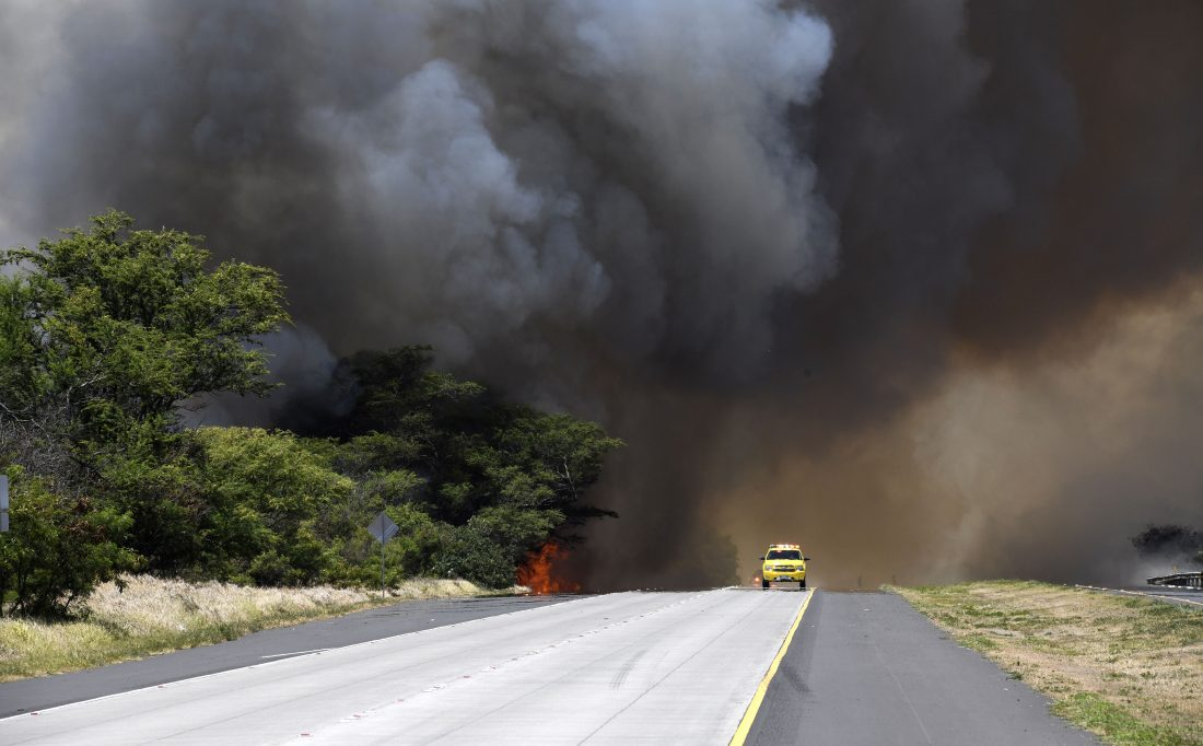 A brush fire shut down Kuihelani Highway from Honoapiilani Highway to Maui Lani Parkway. The fire was reported at 10:42 a.m., south of the Kuihelani Highway-Waiko Road intersection. The Maui News / MATTHEW THAYER photo