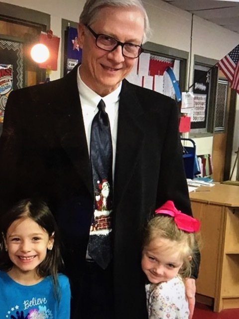 Dr. Bibb with two Tipton County Kindergarten students in 2016