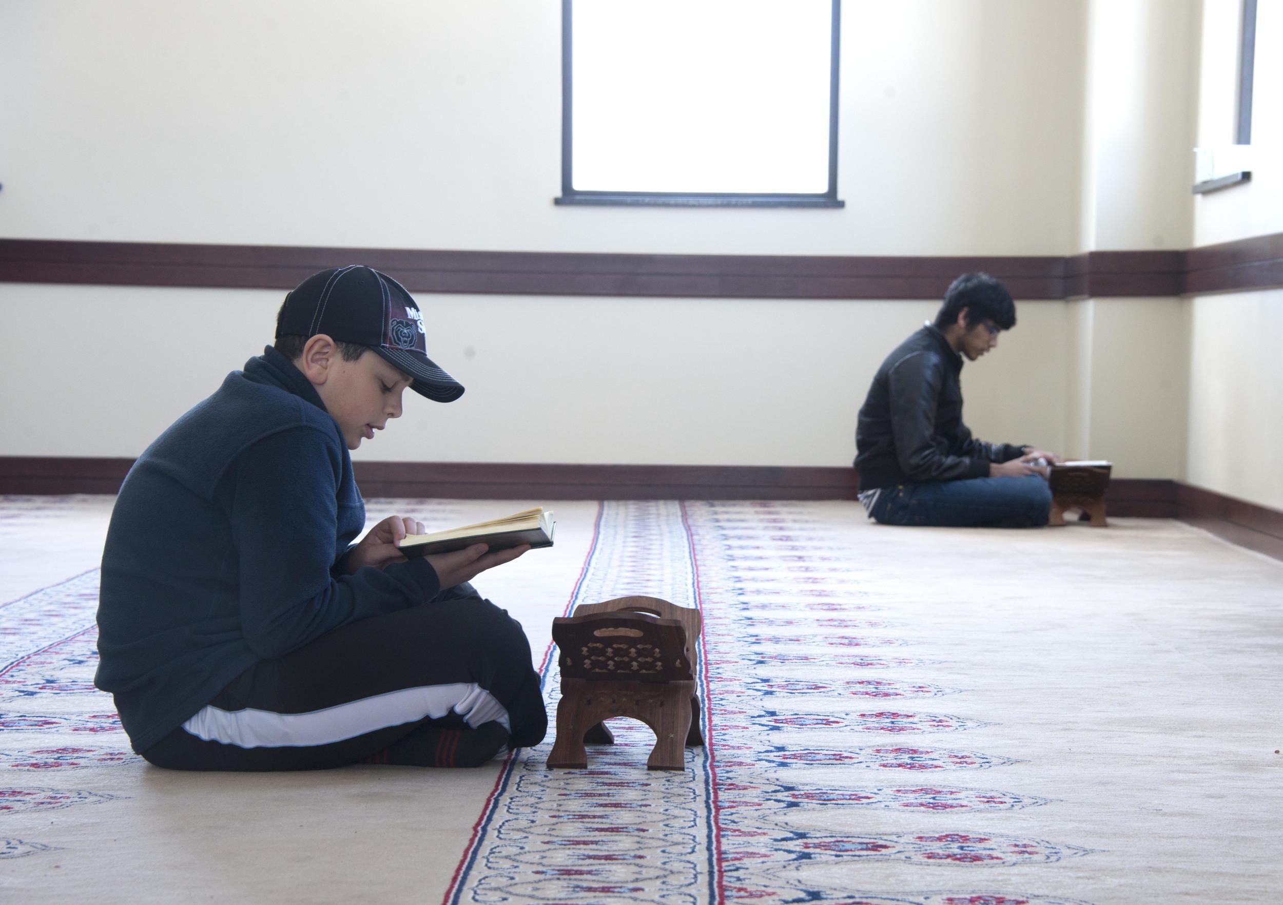 Children read the Quran