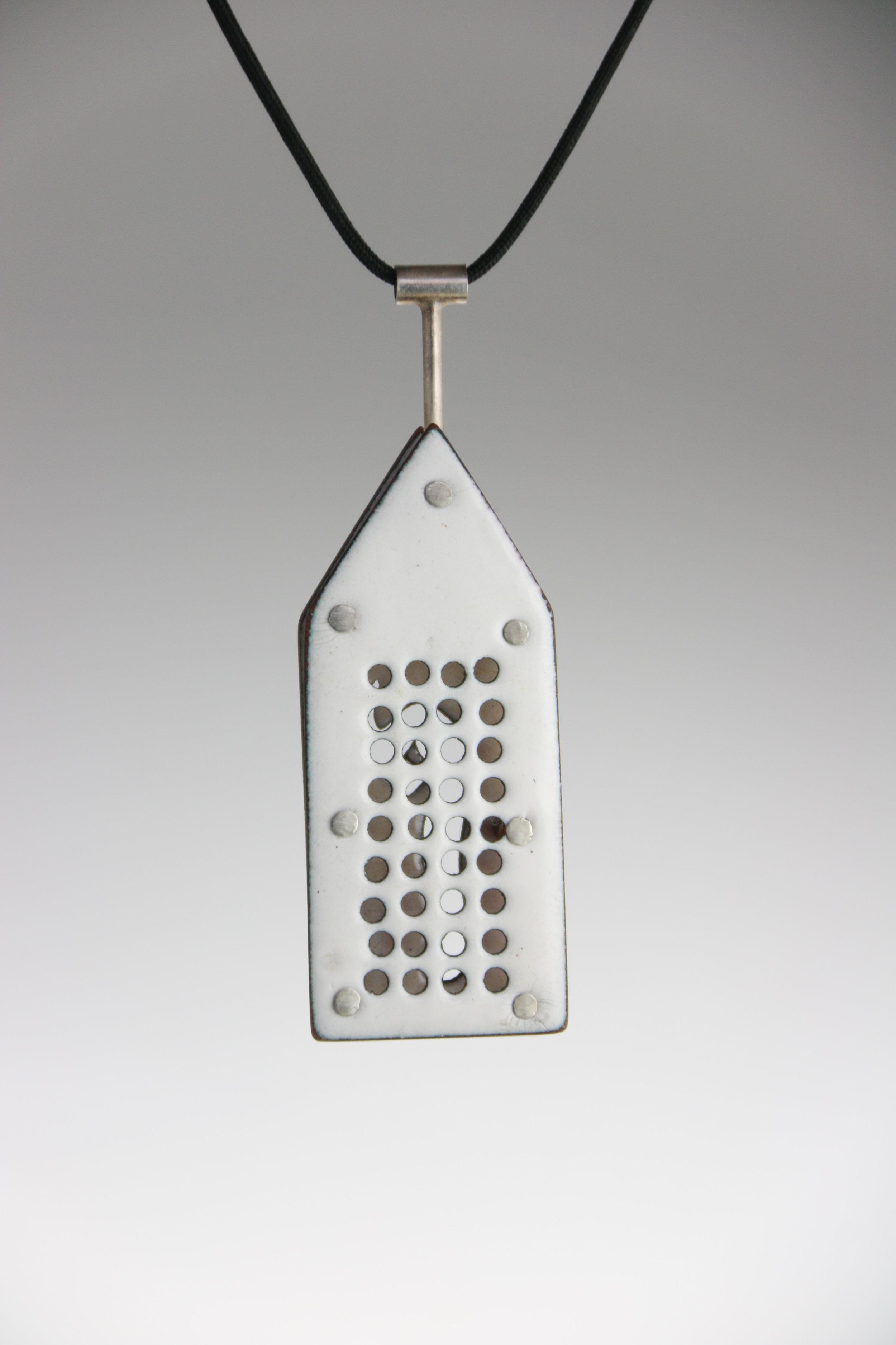 """sterling silver, enamel  2.5"""" x 1"""" x .35""""  (side one)"""