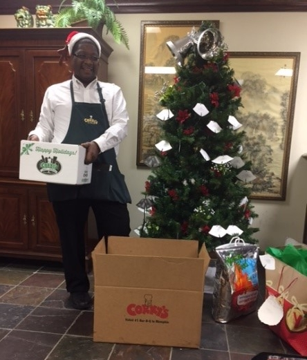 Thomas Bell, representing Cory's delivering a meal for a homebound senior.