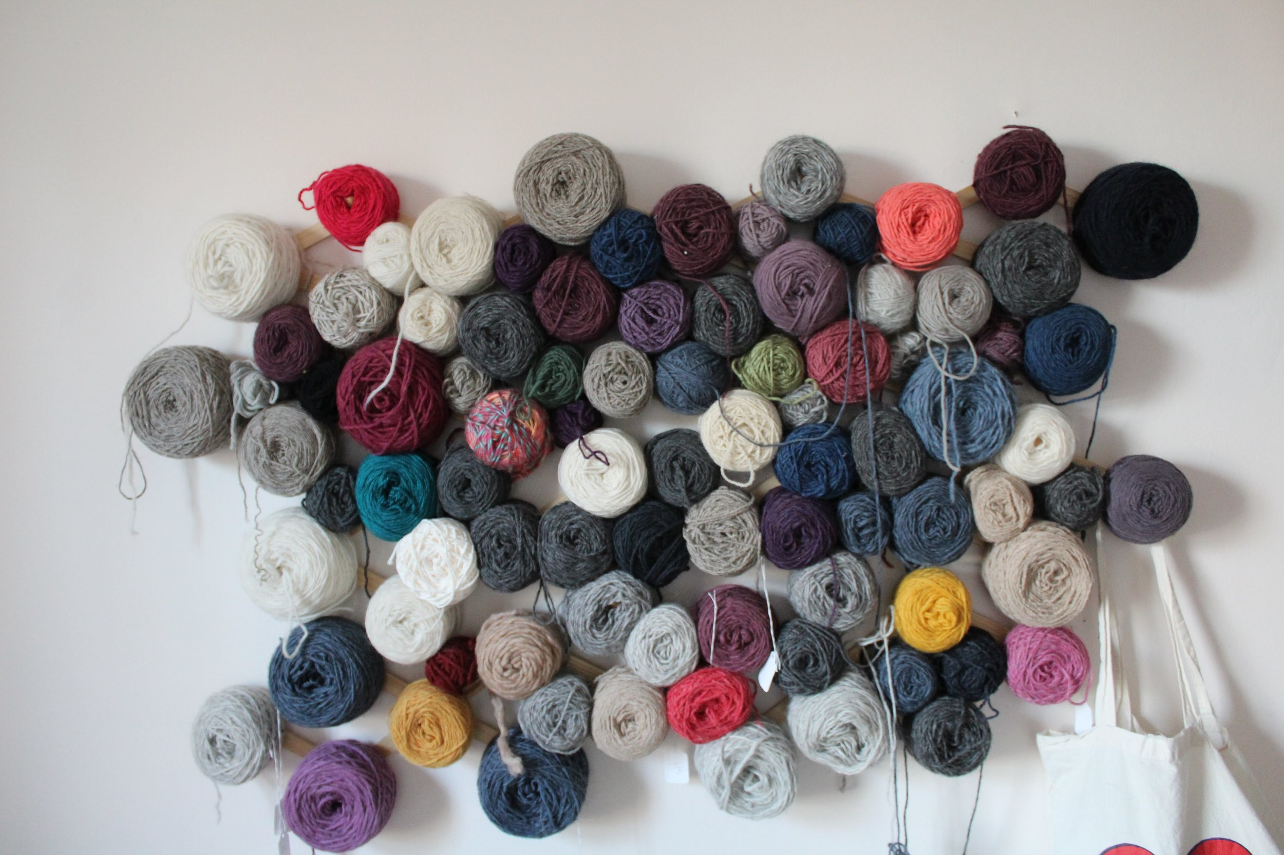 My wall of yarn, waiting to become tiny scarves and sweater (and large sweaters, too).