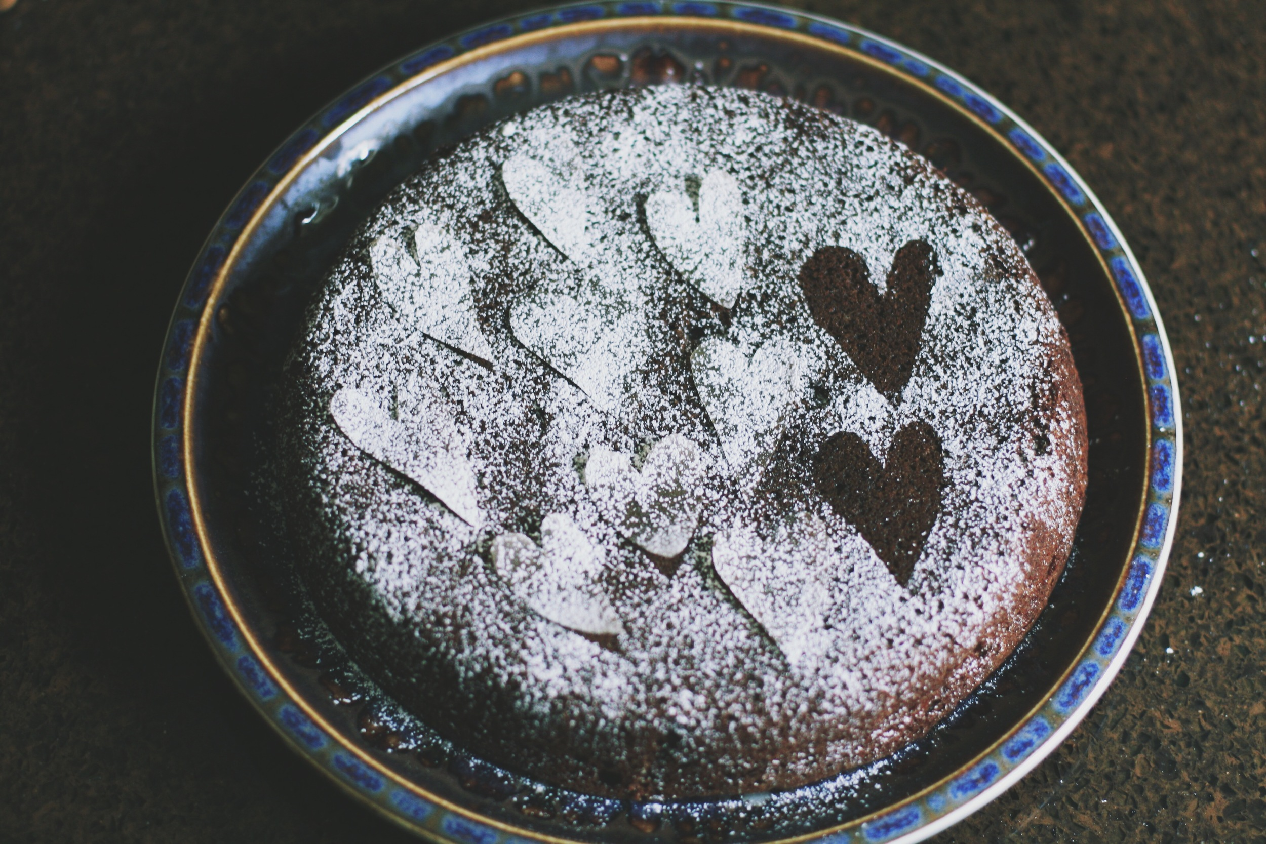 I cut wax paper hearts and sifted powdered sugar over them