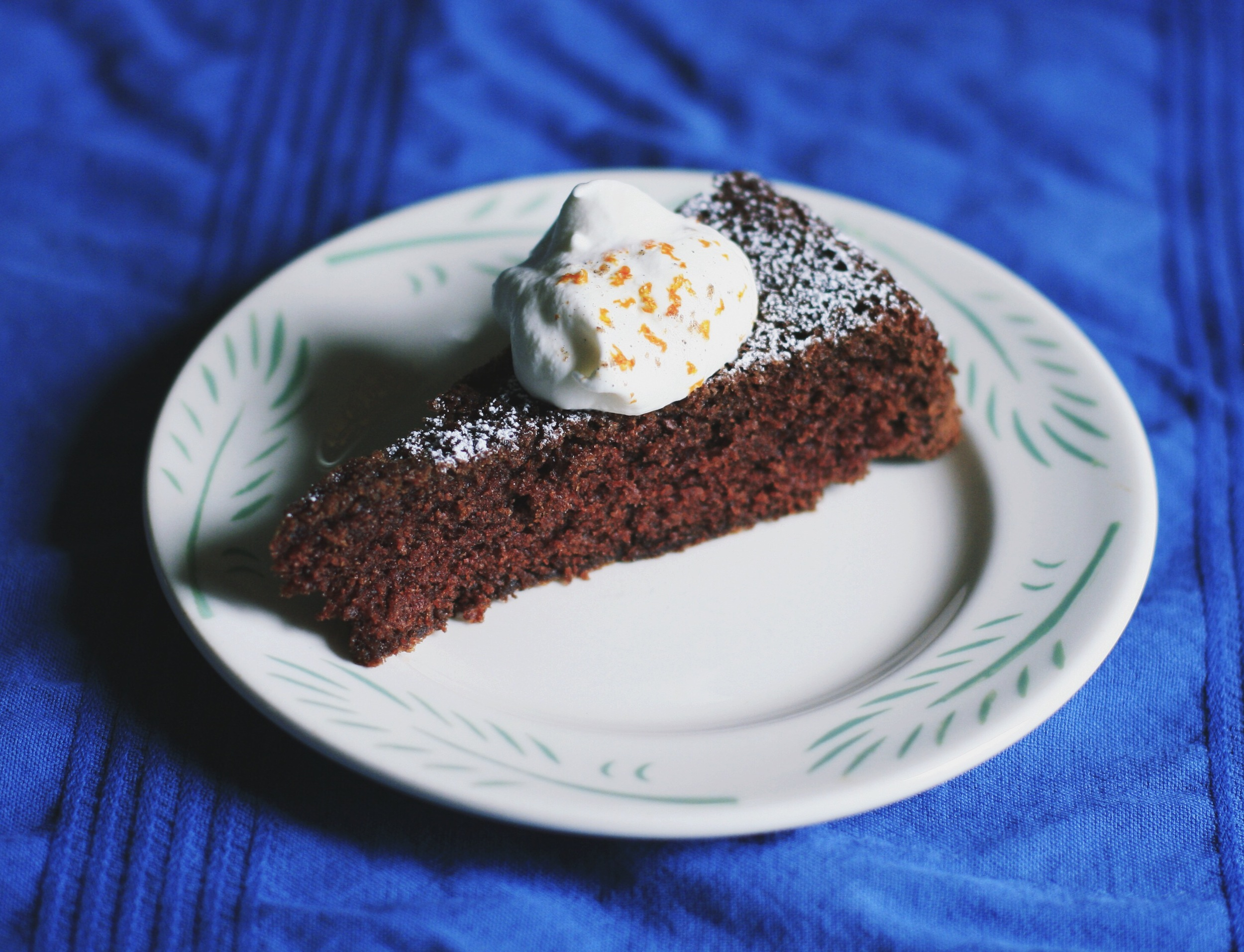 chocolate cardamom cake with spiced whipped cream