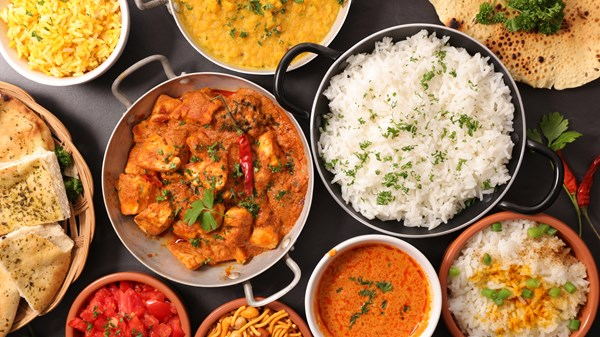 A Tour of Asian Curries from India, Thailand, and Vietnam. Naan Bread, Chutney, and Jasmine rice dishes. -