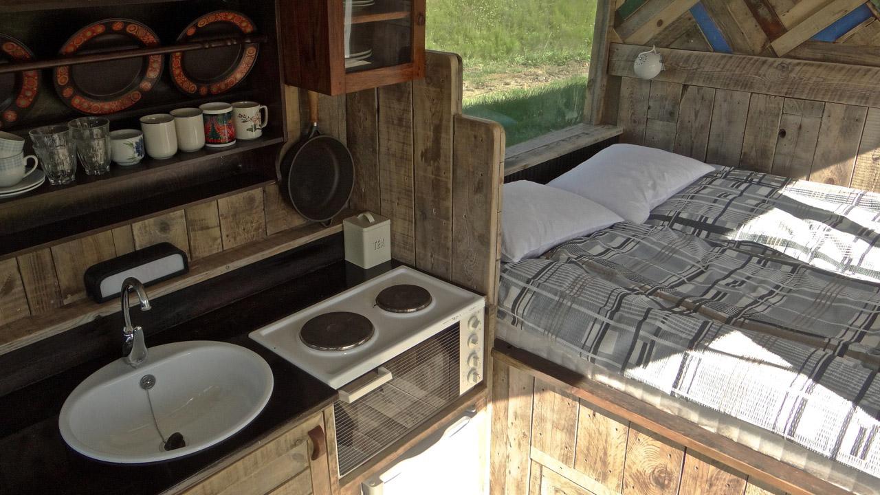 esjan_glamping_in_iceland_interior_bed_and_kitchenette.jpg