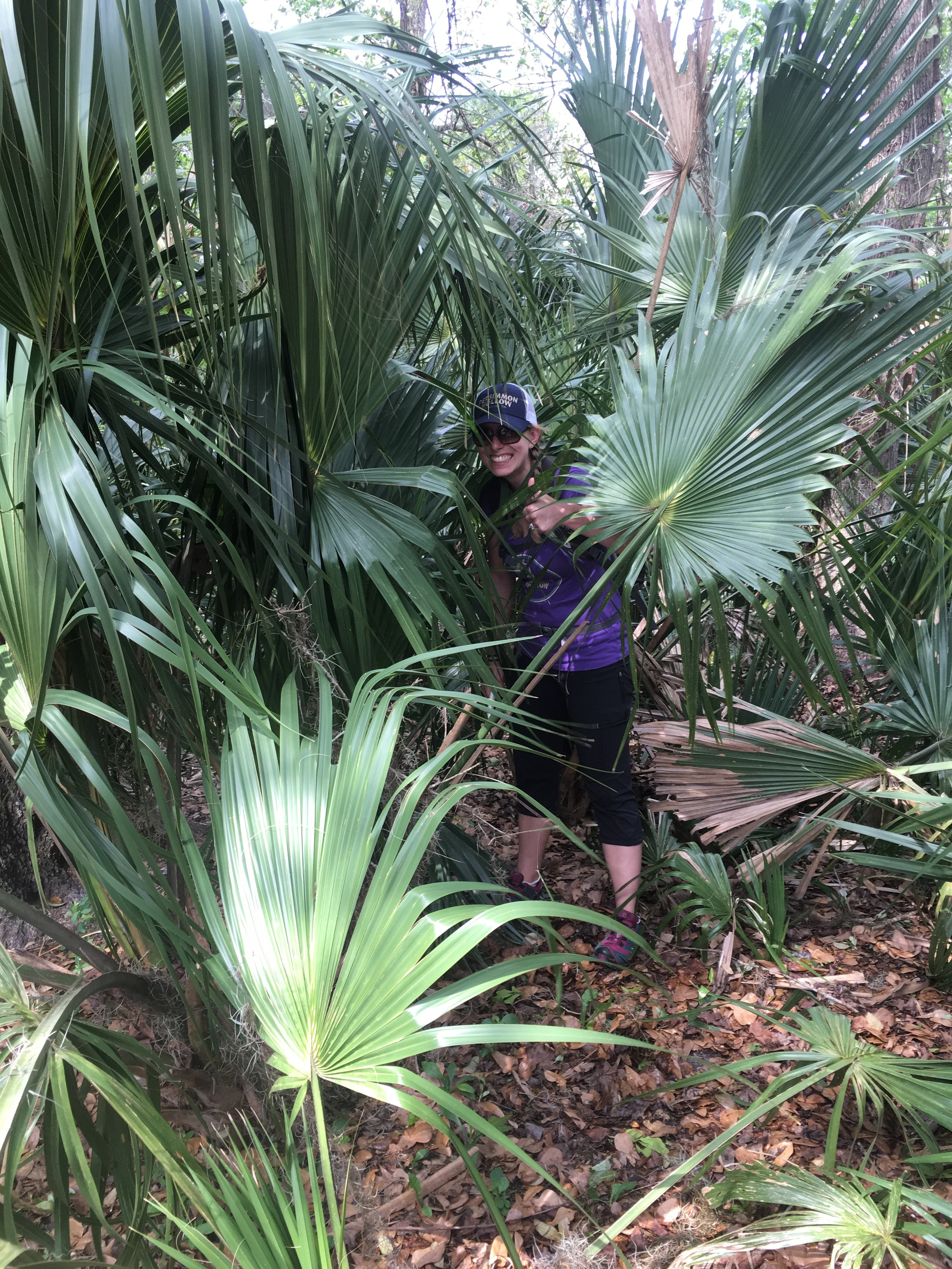 """Pictured: Team Arboreal Contact's """"Snacks"""" sharing her extensive knowledge of native Florida foliage."""