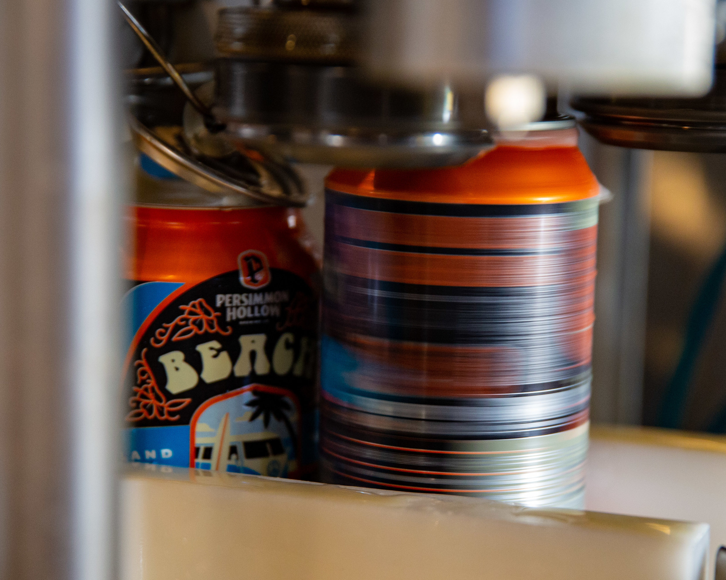 Pictured: A can of Beach Hippie IPA moving through the canning process.