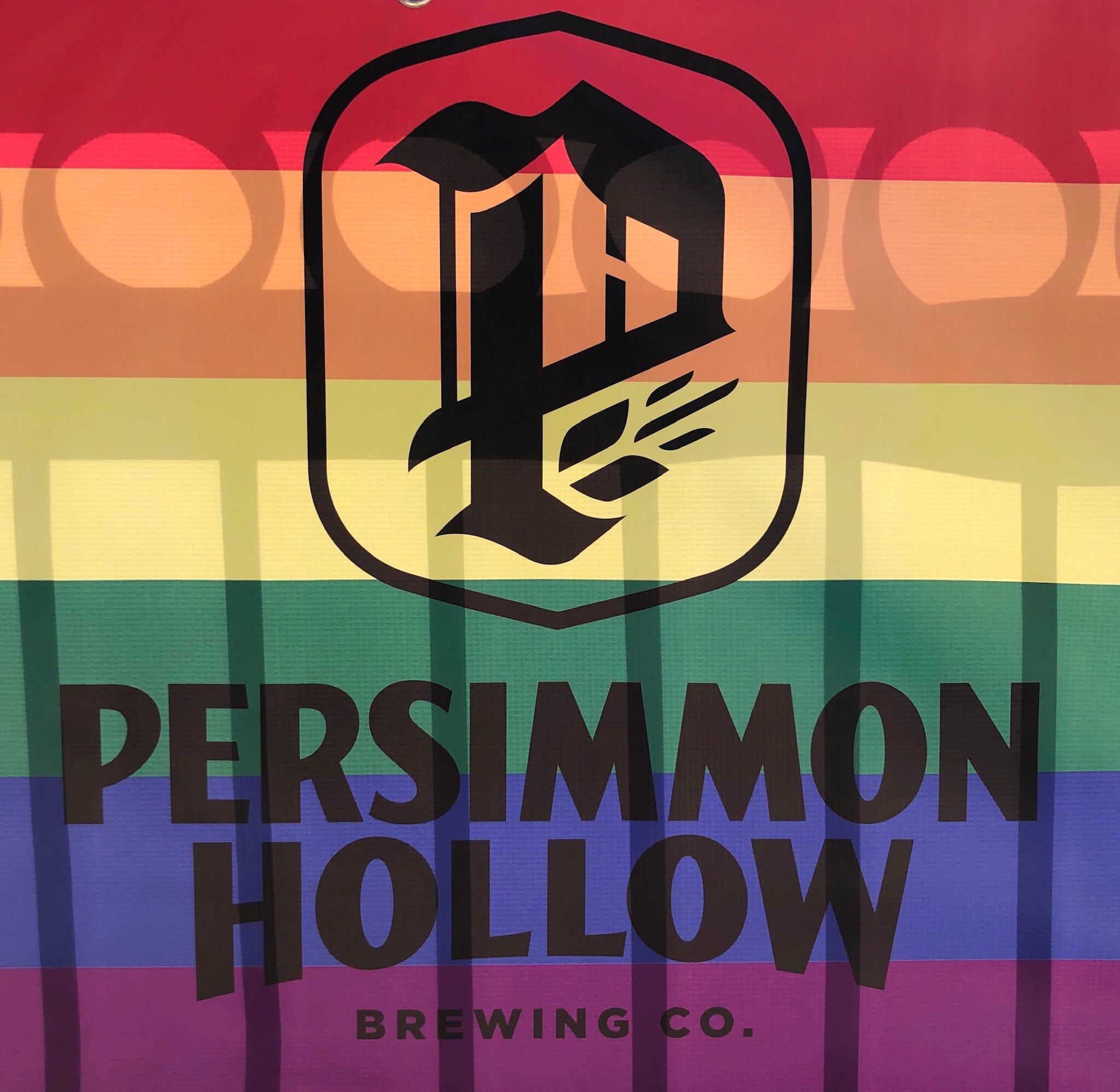 Pictured: Persimmon Hollow banner at the Come Out With Pride Orlando Festival on October 12.