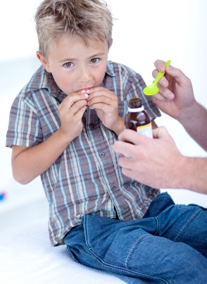 cutcaster-902109877-Cold-child-taking-syrup-small.jpg