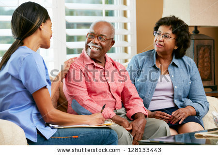 stock-photo-nurse-making-notes-during-home-visit-with-senior-couple-128133443.jpg