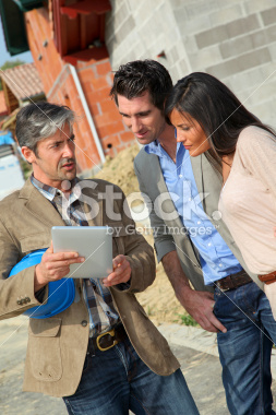 stock-photo-18444679-couple-visiting-property-under-construction.jpg