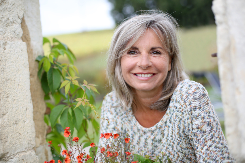 Portrait of serene mature woman in garden